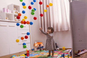 Image representing the news: HW-0120-A004_Toddler girl chasing coloured balls_A