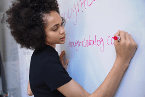 Image representing the news: LFL-0220-A005_Teacher writing on whiteboard_A